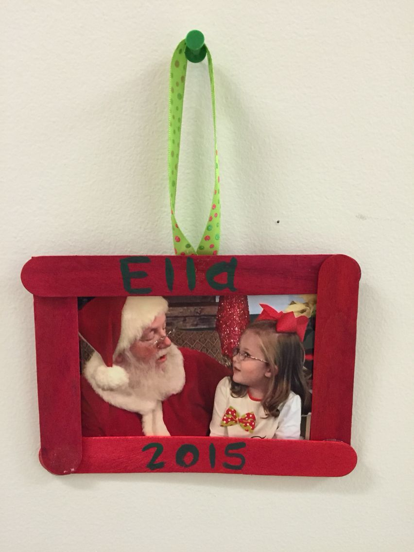 Craft sticks make great frames for the Christmas pictures. Use hot glue. Attack some ribbon to make it an ornament for the tree.