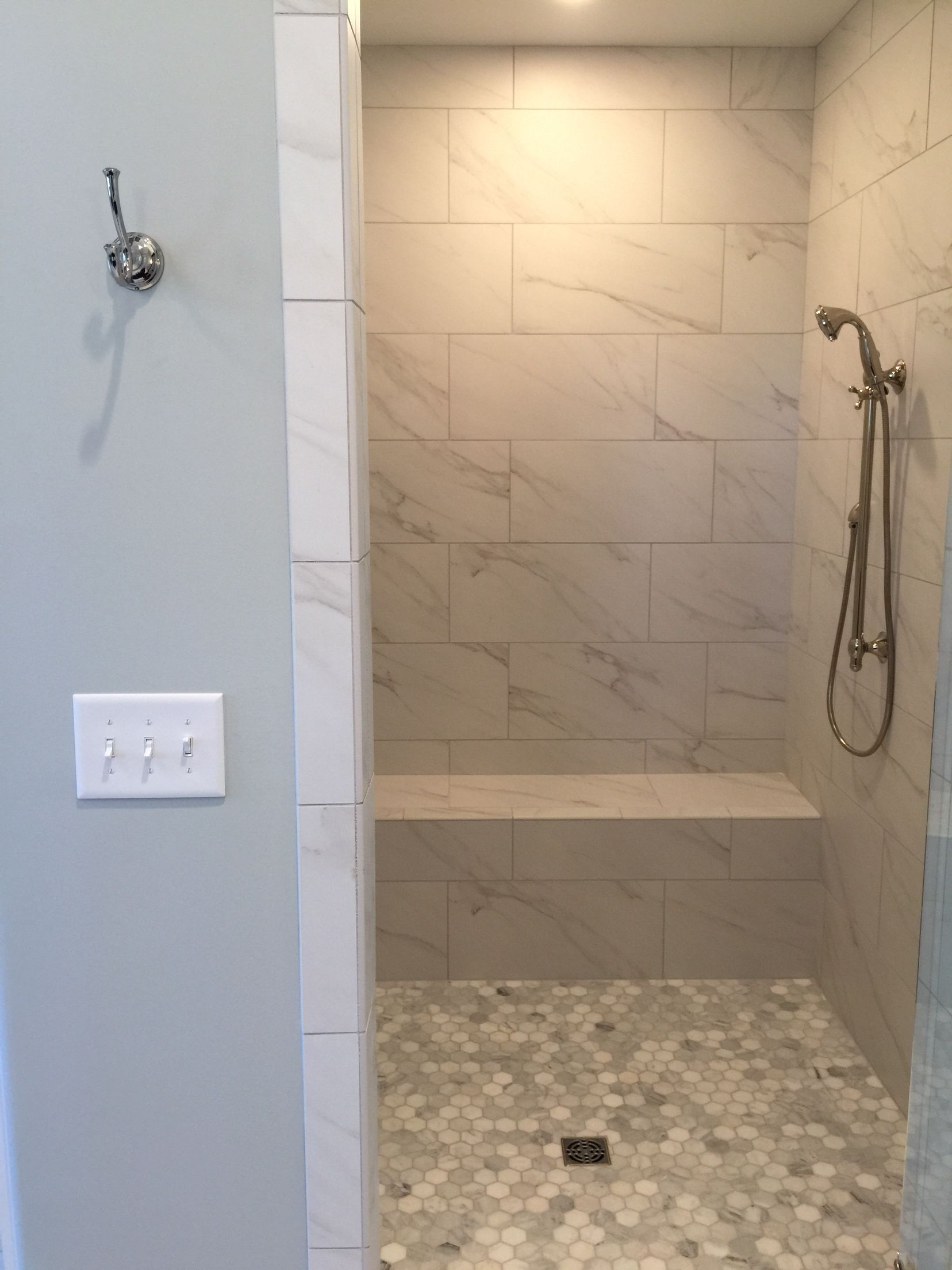 Hexagon Marble Tiles Paired With 12x24 Running Bond Subways Sherwin Williams Silver Strand Walls Bathroom Remodel Master Tile Bathroom Bathroom Makeover