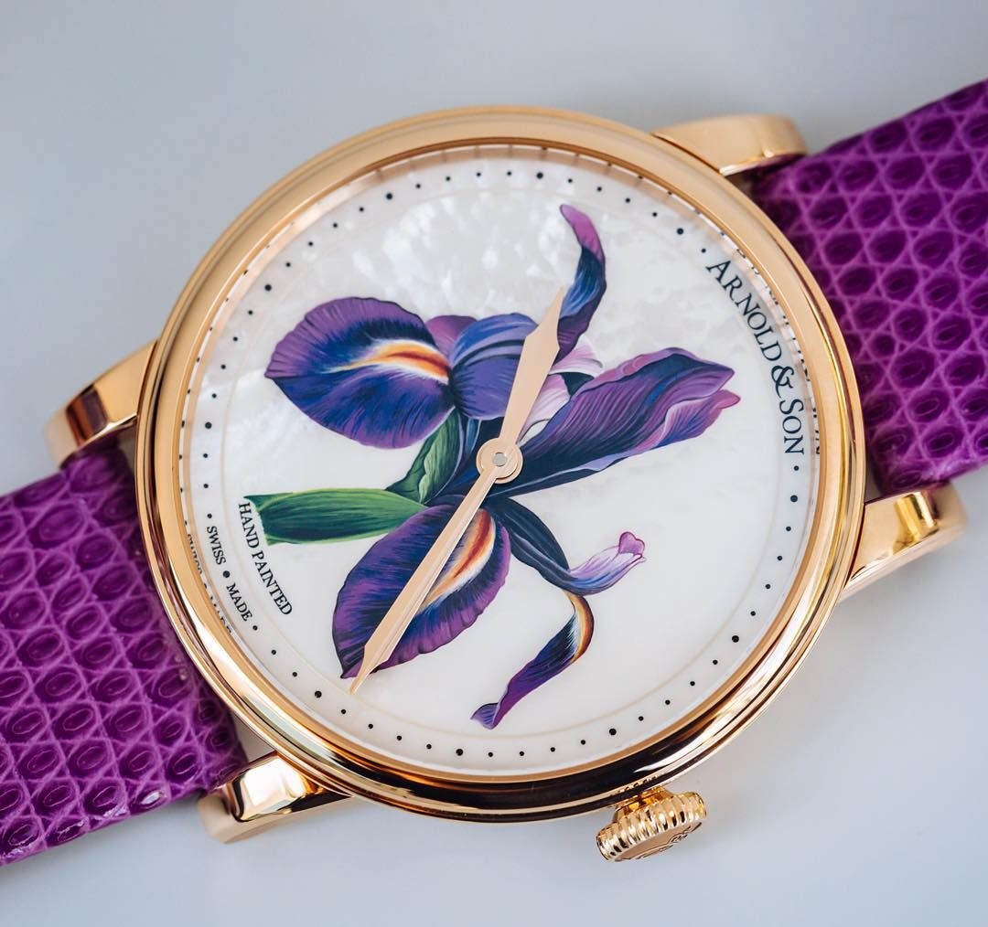 Style grace and the most delicate brushstrokes: the HM Flowers with hand-painted purple iris on a white mother of pearl dial base. by arnoldandson