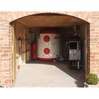 Case study of a wood gasification log boiler in a 6 for Alternative heating systems for homes