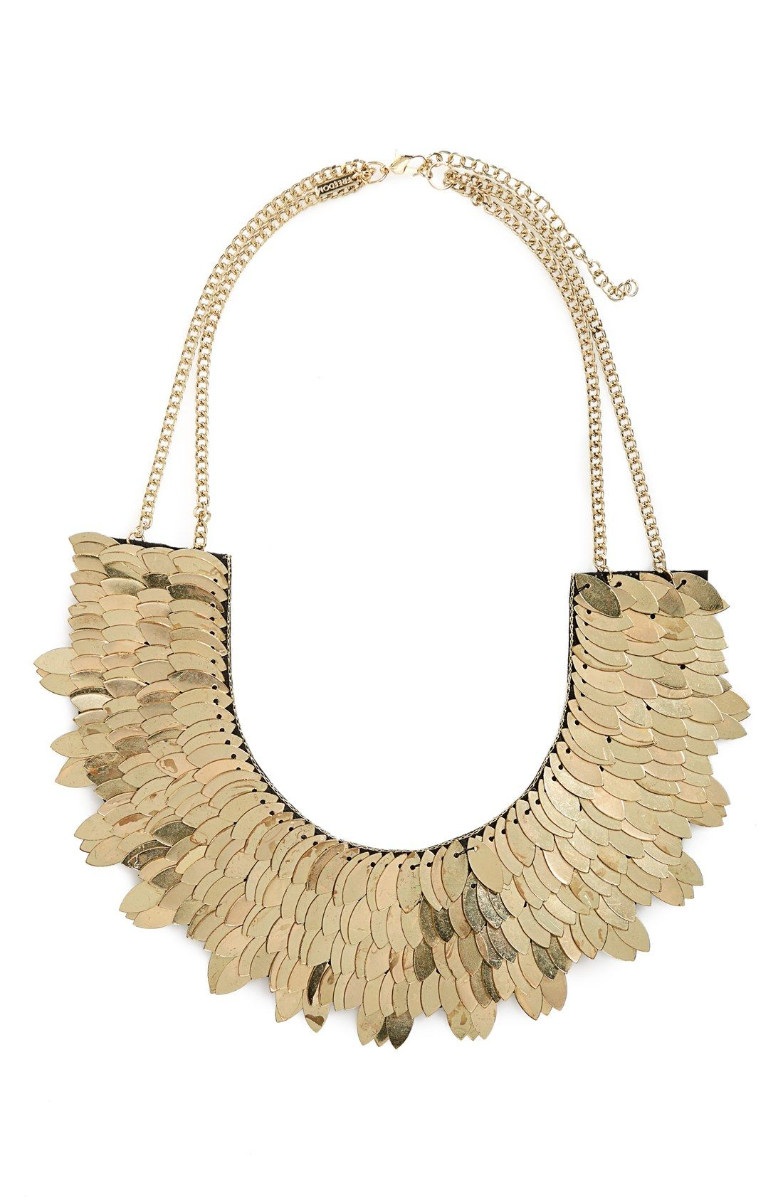 Radiant brass leaves are layered across the bib of this attention-grabbing collar necklace for a glamorous look.