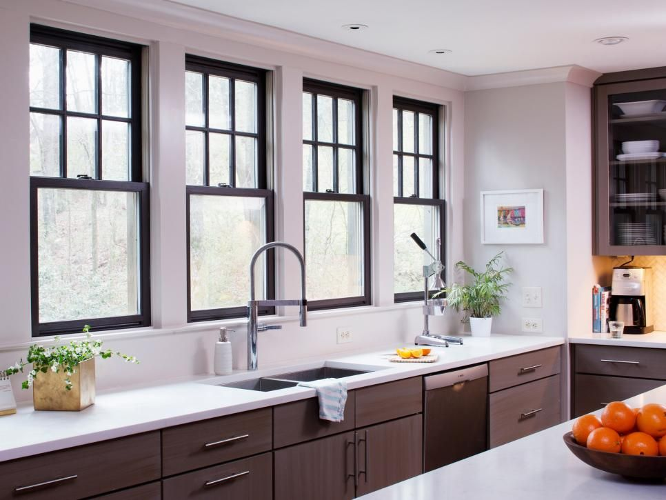 the window muntins and sashes are painted sherwin williams sealskin almost black which on kitchen interior with window id=82653
