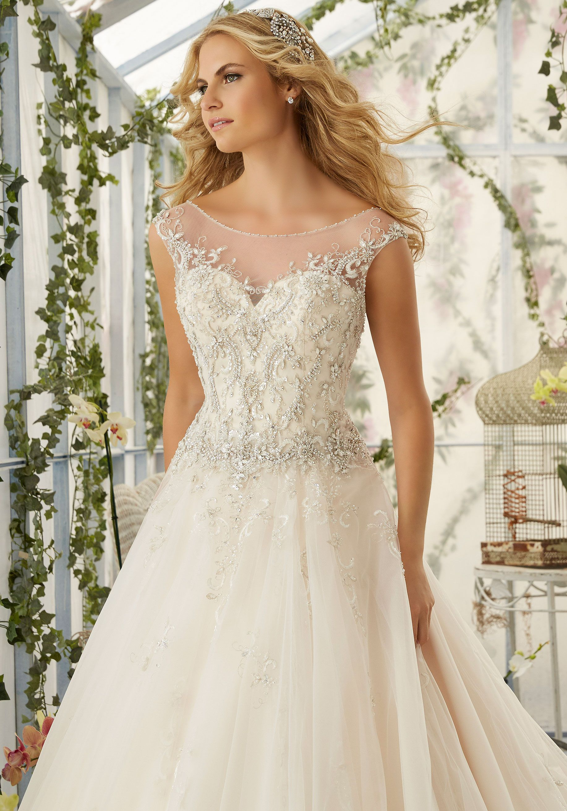 379894abc81 Intricate Crystal Beaded Embroidery Decorates the Tulle Ball Wedding Dress.  Colors available White Silver