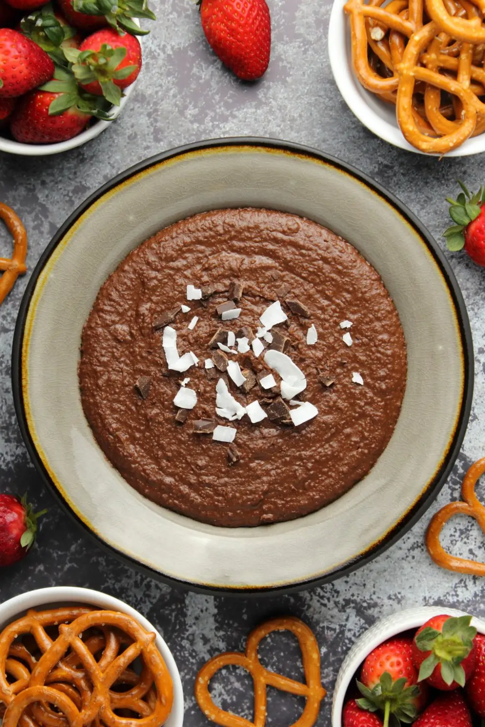 Delicious chocolate dessert hummus! Amazing as a dip for fresh fruit or pretzels, or just to eat with a spoon! High in protein and fiber, vegan and gluten-free! | lovingitvegan.com #desserthummus
