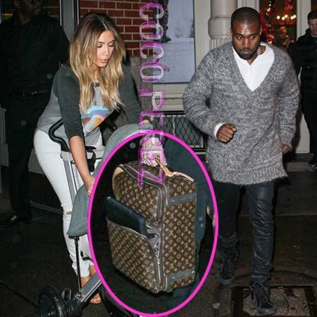 3ad0147031ea Kanye West and Kim Kardashian are spotted in New York with Louis Vuitton  luggage right after Kanye announces everyone should boycott LV until  January!