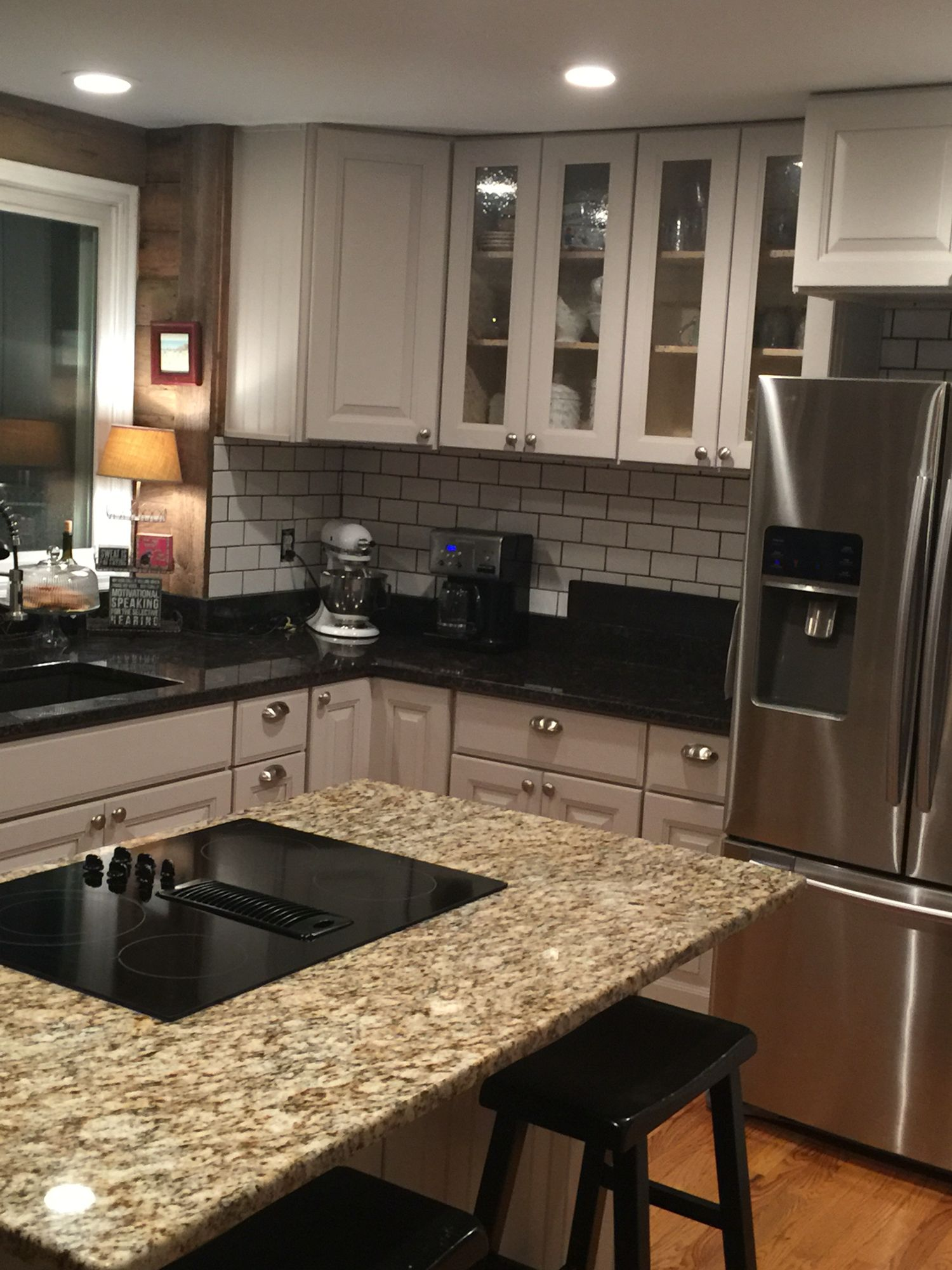 rustic kitchen with white subway tile and charcoal grey