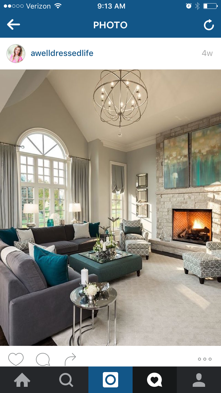 Benjamin Moore - Stonington Grey such a great paint colour. Love this living  room with the stone fireplace, large chandelier and teal accents. home decor .