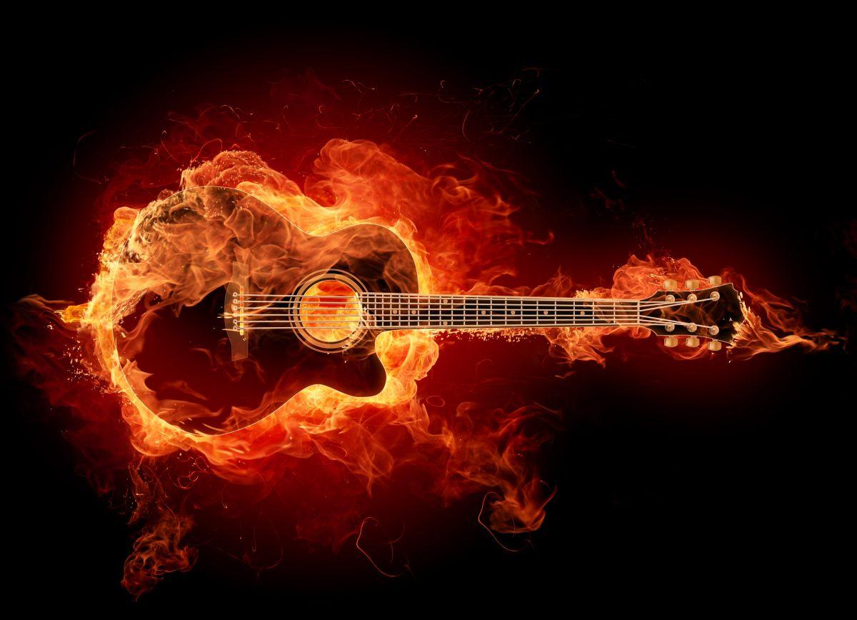Como bien expresa esta foto, la guitarra es mi pasión.    Ingrid Yrrivarren.