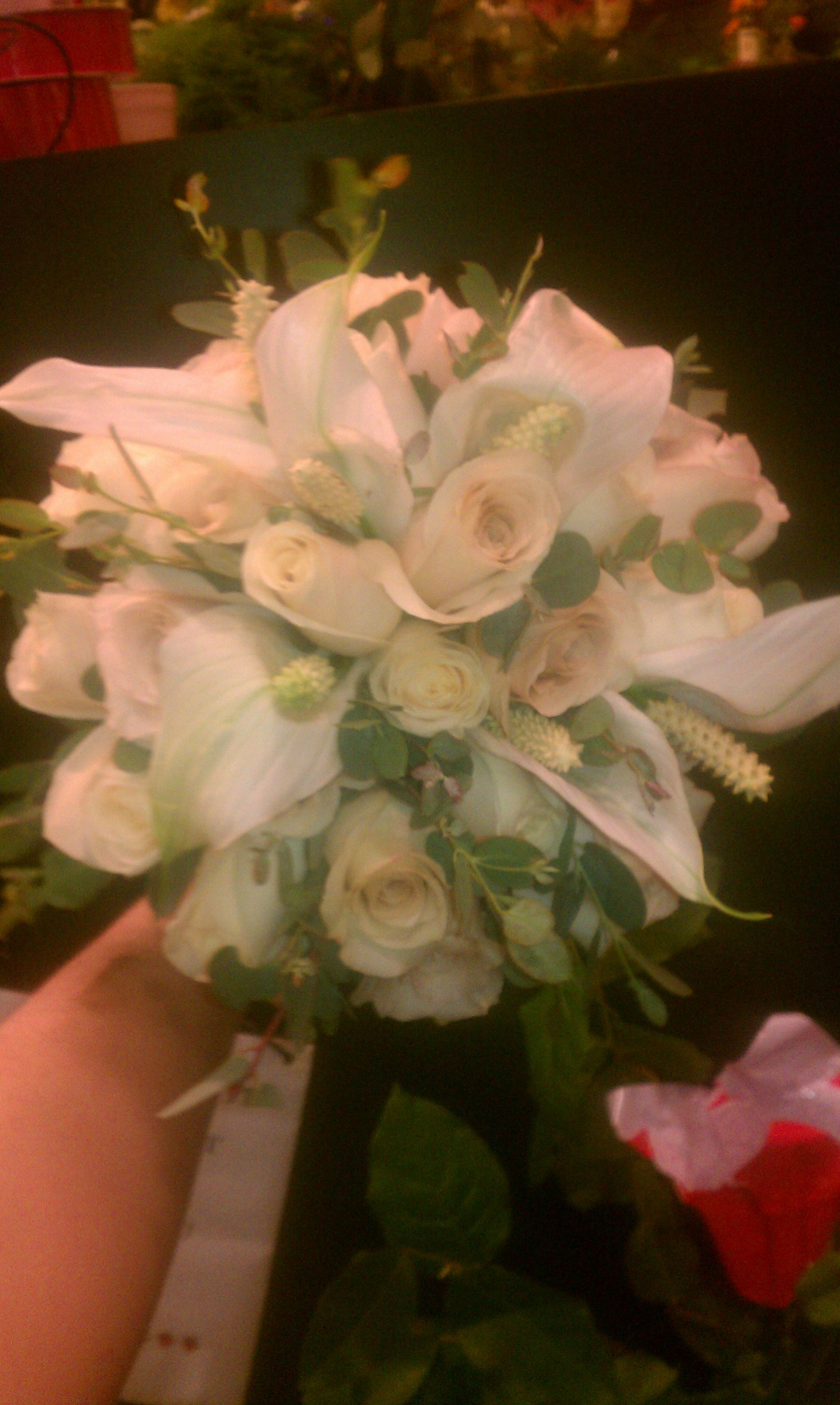 Top view of bridal bouquet vendella roses quicksand roses peace top view of bridal bouquet vendella roses quicksand roses peace lily blooms dhlflorist Gallery
