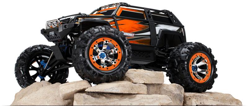 Summit 56076 4 Three Quarter View On The Rocks Orange Monster Trucks Traxxas Rc Monster Truck