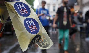 "A supporter of the Remain campaign with stickers saying ""I'm in"""