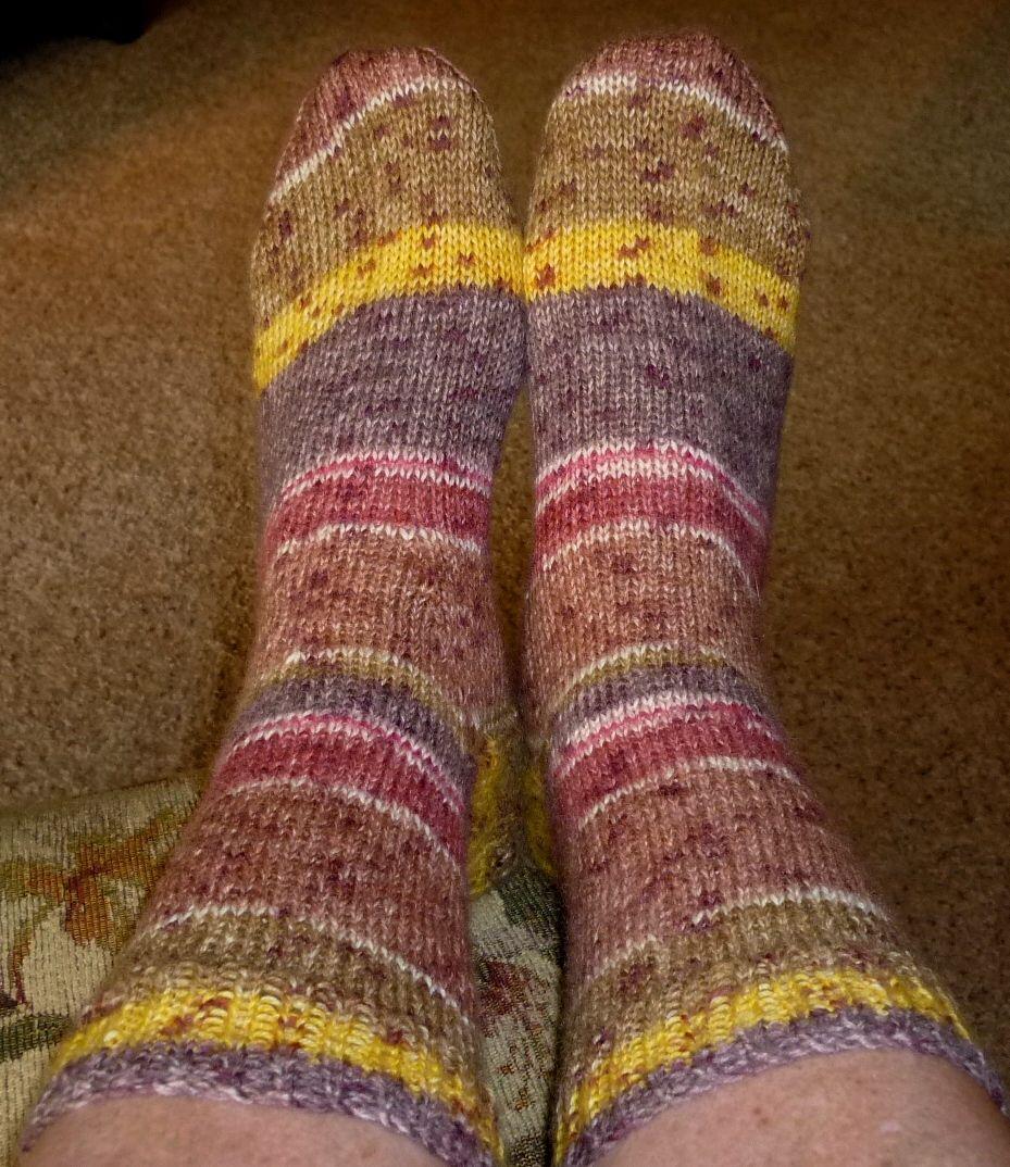 Socks knit with self striping yarn on two circular needles ...