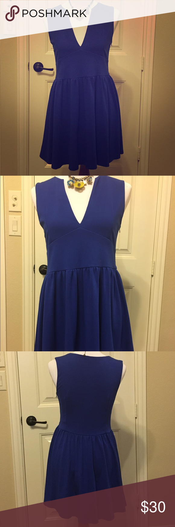 """Cute Royal Blue dress Adorable blue V-neck dress. Measures approximately 30"""" from shoulder to hem. Very very tiny pull at base of v-neck (see photo). 100% polyester. This dress is pretty short, so would probably be best for someone on the shorter side or to be worn with leggings or tights. Runs slightly small. daily look Dresses Mini"""