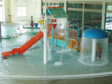 The grove at inver grove heights community center zero depth entry splash pool water slides for Citywide aquatics division swimming pool slide