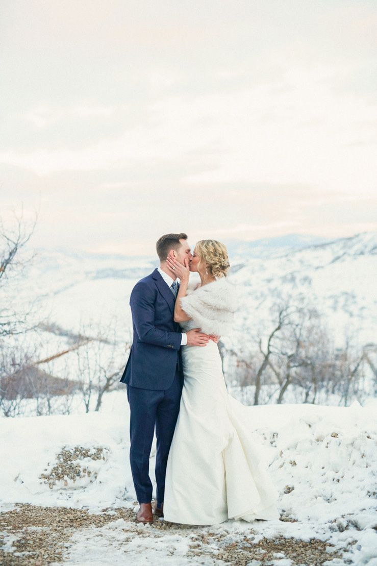 Bride and groom in snow wedding photo idea | fabmood.com