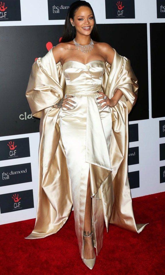 Rihanna rocks a golden gown at the 2nd annual Diamond Ball in Santa ...