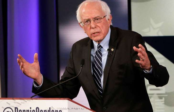 U.S. Democratic presidential candidate Bernie Sanders was invited to speak at an April 15 Vatican event by the Vatican, a senior papal official said on Friday, denying a report that Sanders had invited himself.