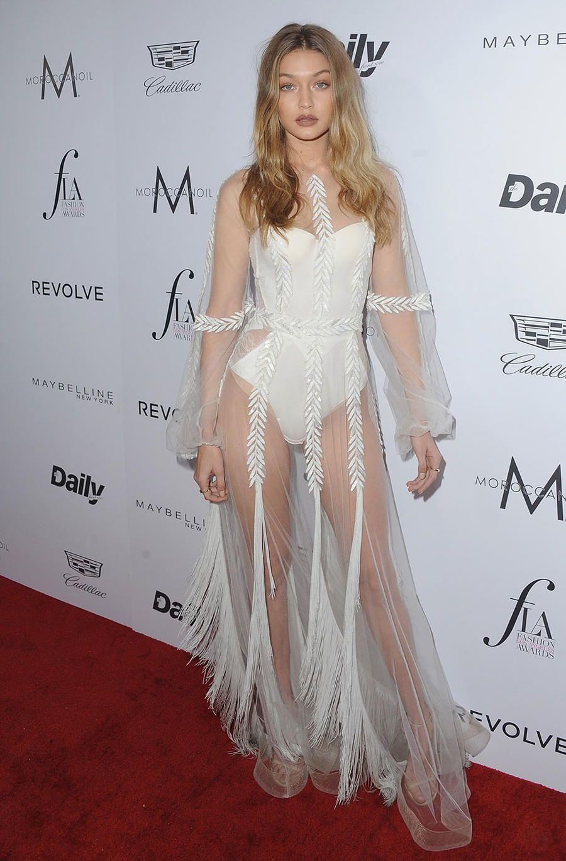 b7948121 Gigi Hadid Slays The Naked Dress Trend As She Hits The LA Fashion Awards  With Bella Hadid And The Weeknd | MTV UK