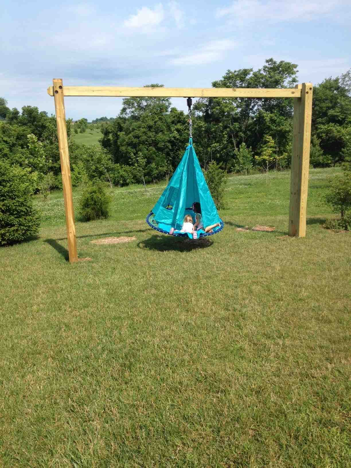 Even Without Trees Now Our Kids Can Swing Used A Hearthsong Sky Island Swing Which Is 5 Feet In Diameter And P Backyard Fun Backyard For Kids Diy Tire Swing