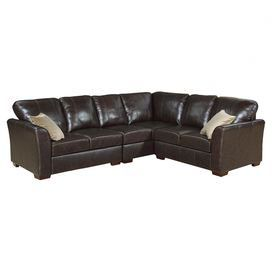 "Leather sectional sofa with wood frame and foam padding. Includes two complementing accent pillows. Product: Sectional sofa  Construction Material: Wood, foam and top grain leather  Color: Dark brown  Features:   Strong stitched panel designTwo accent pillows included  Dimensions: 37"" H x 112"" W x 38"" D       Note: Some assembly required"