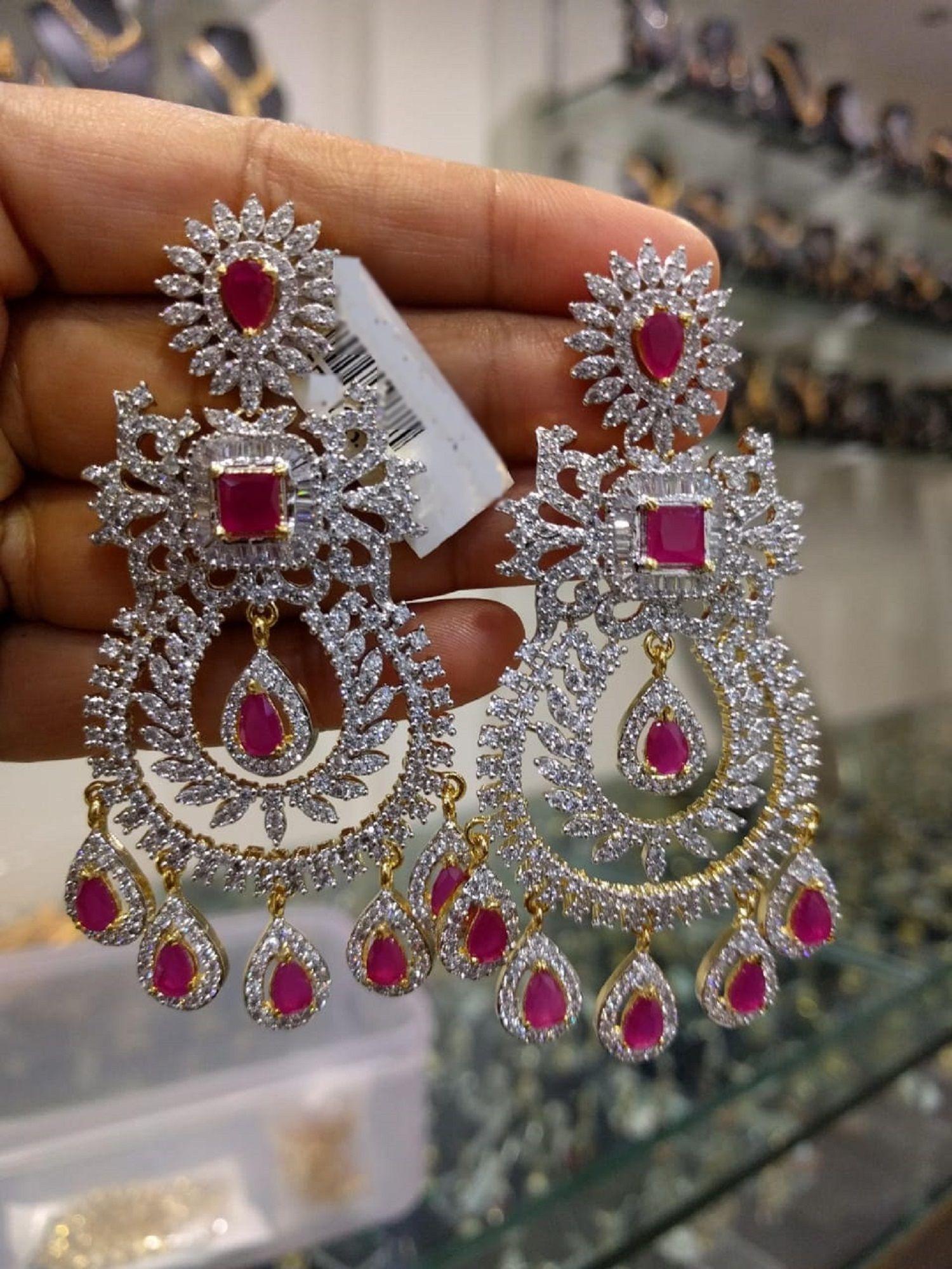 1 Gm gold earrings or trendy earrings
