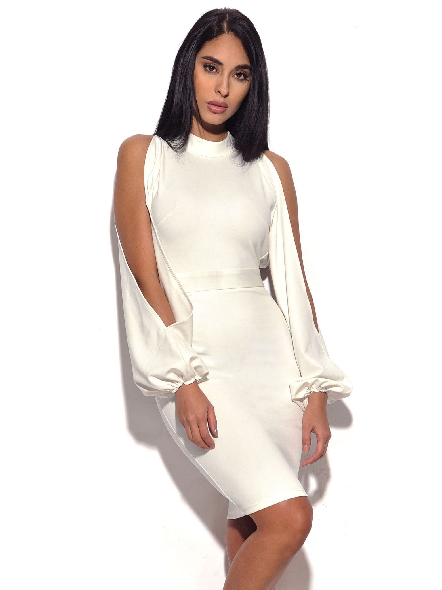 f4aff960e5 This elegant white bodycon dress is perfect for the most upscale events. It showcases  flowy cut out sleeves leading to a high neck and open back.