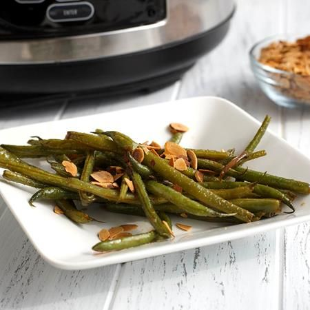 Green beans get an upgrade with this delicious slow cooker side. Cooked with butter until tender, a glaze of McCormick® garlic and onion...