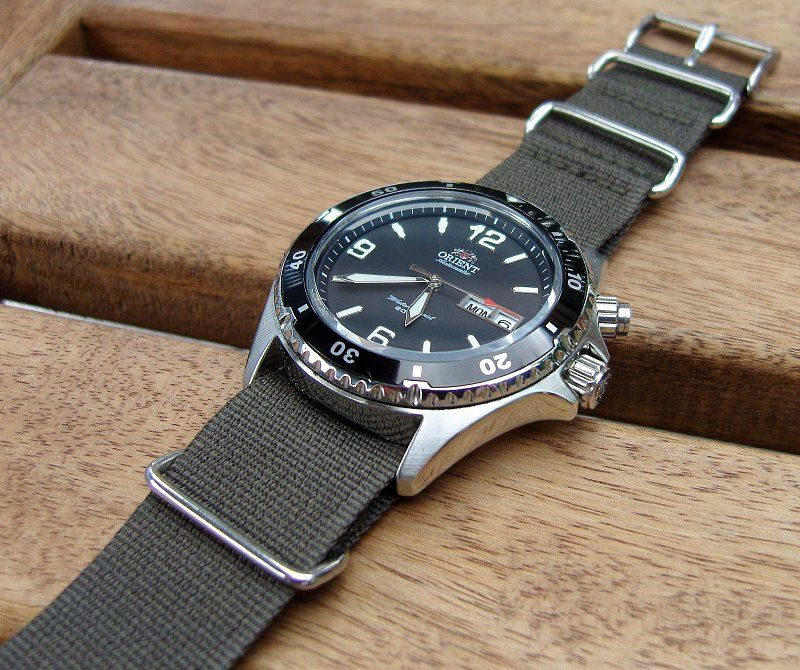 Orient CEM65001B with a replaced James Bond type belt.
