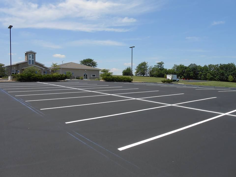 I Love How Clean This Freshly Paved Asphalt Parking Lot Looks Against The Bright Blue Sky I Ve Never Considered Construction Services Business Space Blue Sky