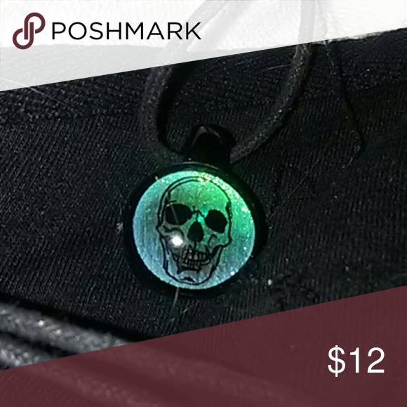 3D skull necklace UNIQUE 3D skull pendant...slightly larger than a marble...almost glows in the dark...neon turquoise base with a full smile, smiling skull face. Really neat piece. Comes complete with fully adjustable neck cord in black. Jewelry Necklaces