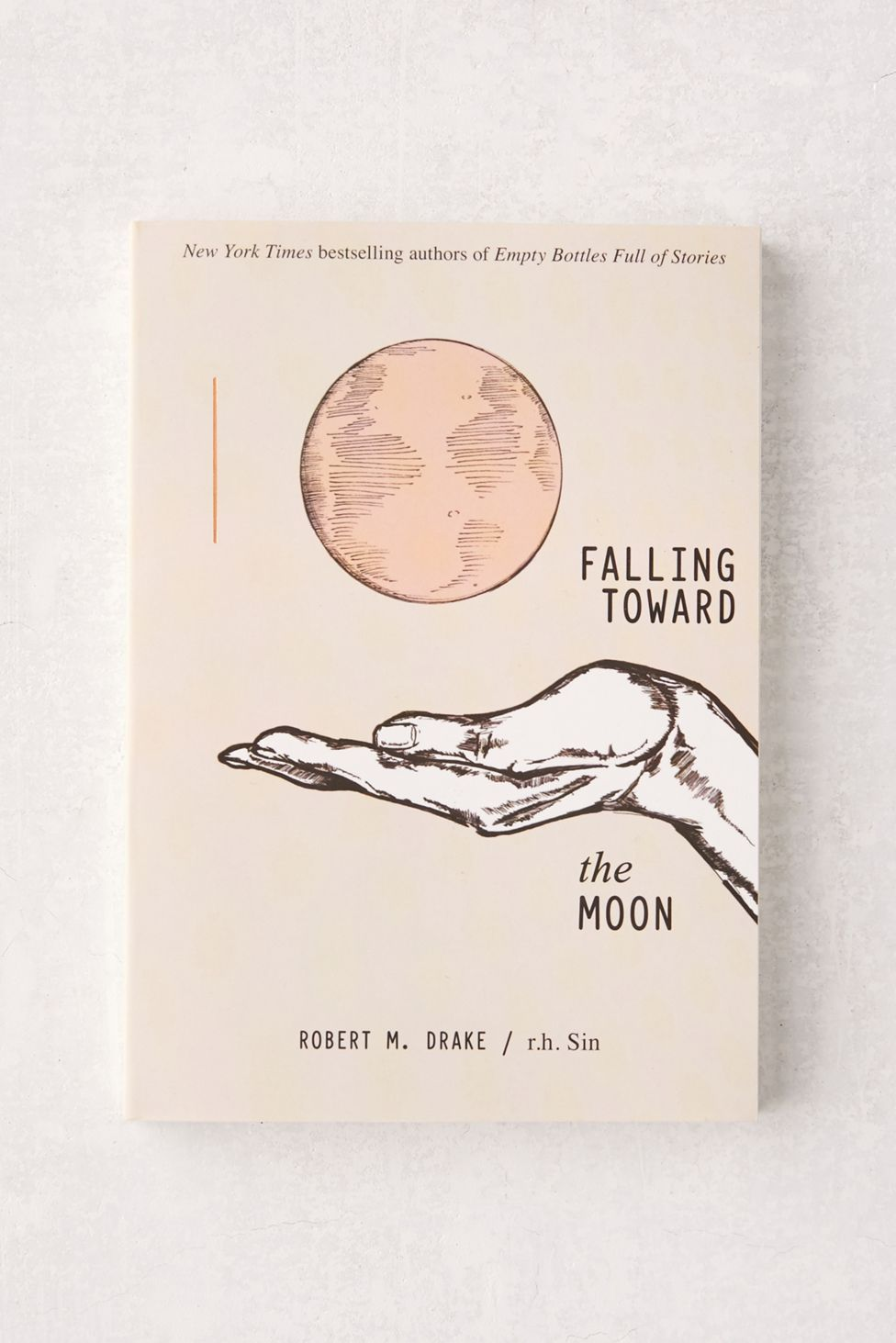 Shop Falling Toward the Moon By r. Sin & Robert M. Drake at Urban Outfitters today.