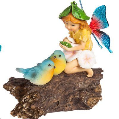 Lend a touch of charm to your garden or walkway with this whimsical cottage statue, featuring a solar powered light and carved design.