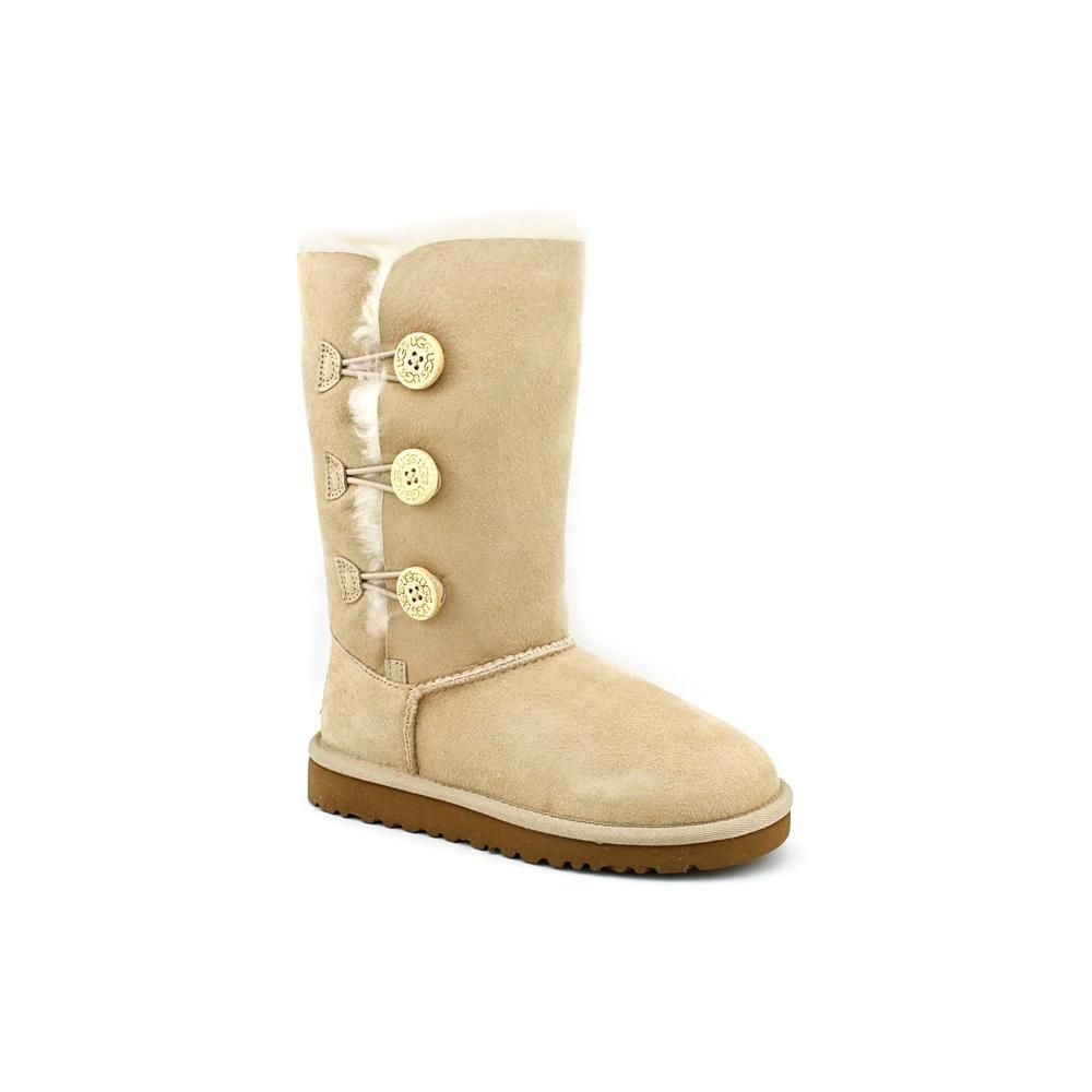 cc2d2b9367f The Ugg Australia Bailey Button Triplet boots feature a suede upper ...