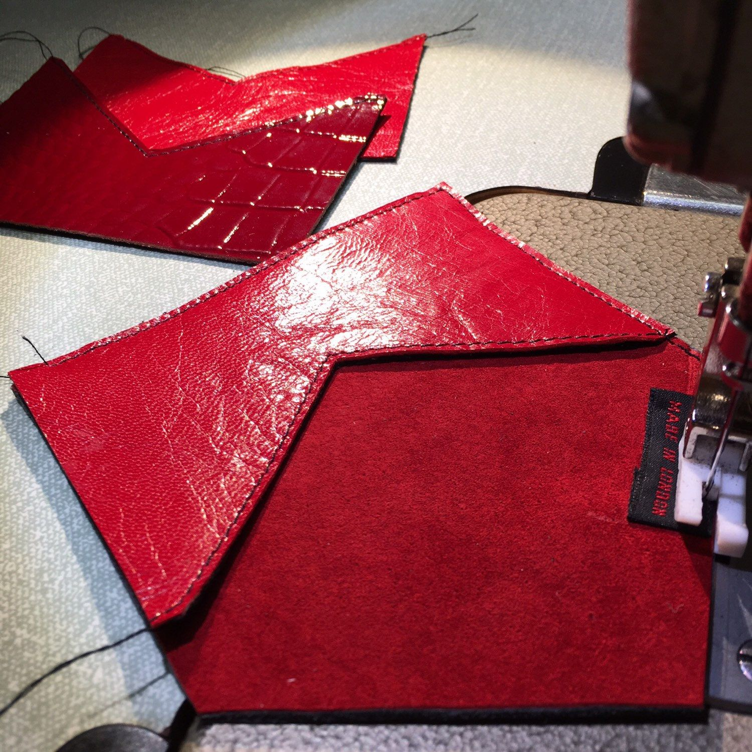 Sewing up some hot lipstick red leather 💋
