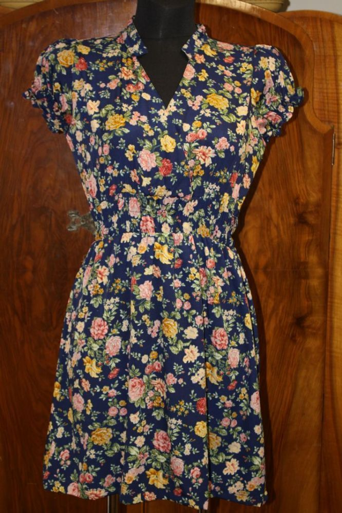 Deirdre is a forties inspired tea dress with a cross over front and little cap sleeves with an elasticated waistband 100