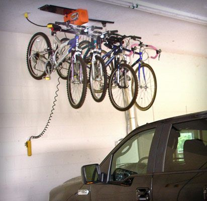 Too Many Bikes And Surfboards In Your Garage Organize And Clean Up The Mess Storage For Garage Bike Storage Systems Bike Storage Bike Storage Rack