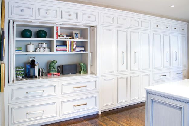 Floor To Ceiling Cabinetry In The Kitchen Conceals A Coffee Bar, Pantry And
