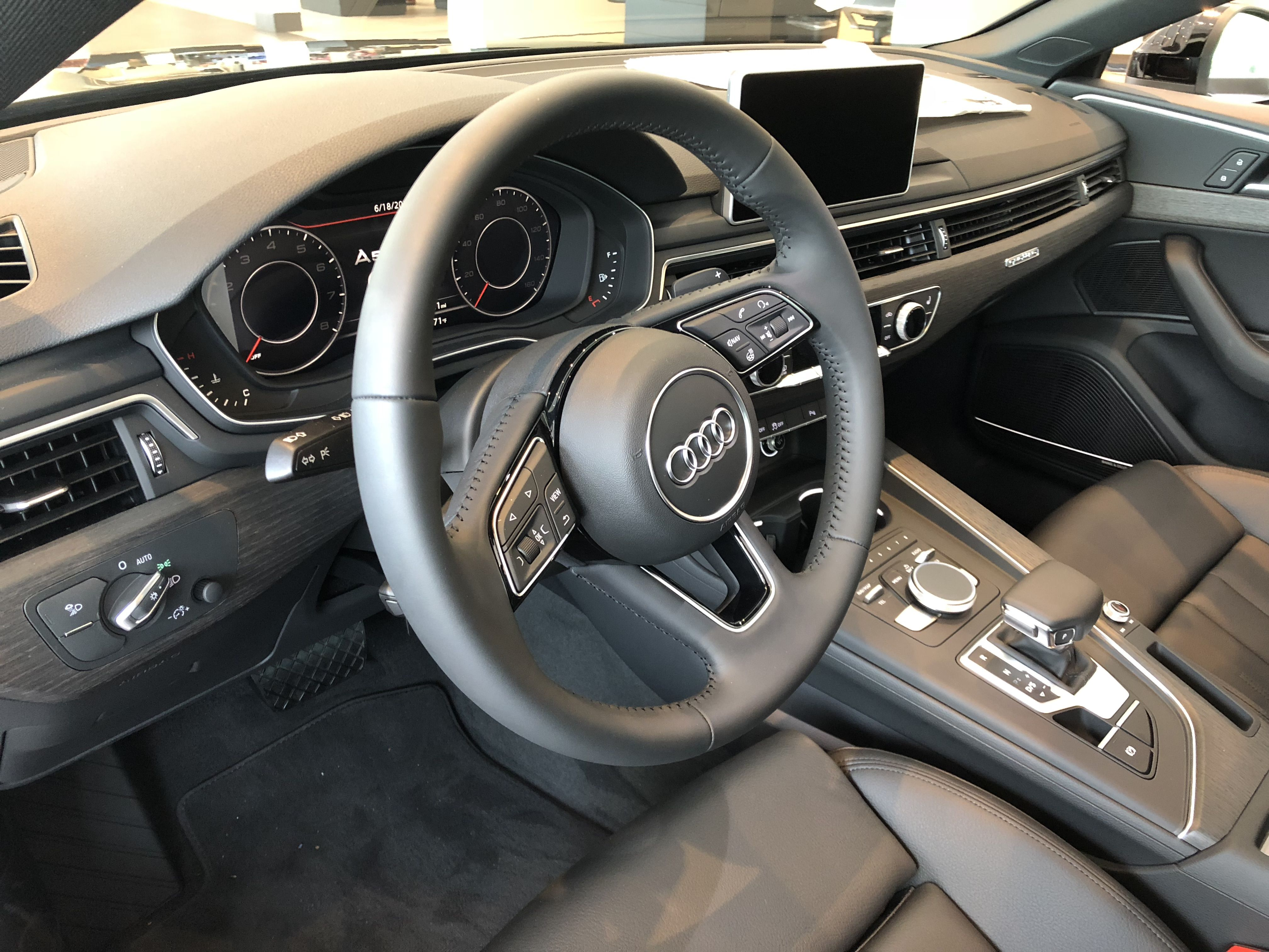 View Of The Steering Wheel And Controls On The 2018 Audi A5 With Black Interior Leather Standard Vehicle Available A Used Luxury Cars Audi Dealership Audi A5