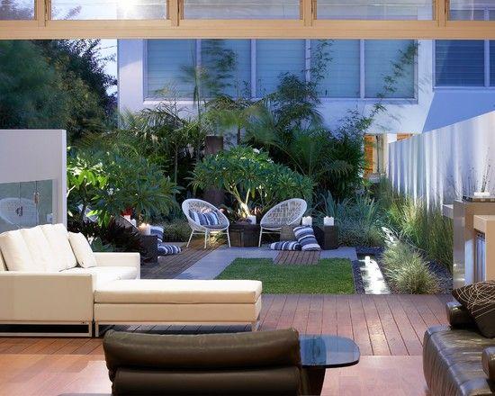 Innenhof Pflanzen Sichtschutz Terrasse Sessel Holz Kies Bauchlein