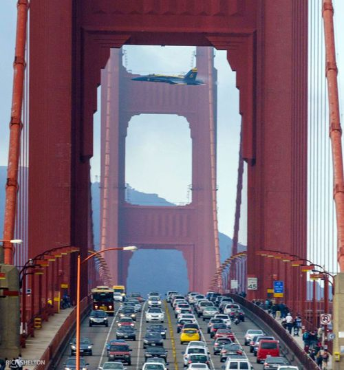 Don't miss it- an F-18 from the Navy's Blue Angels flies thought the Golden Gate Bridge.