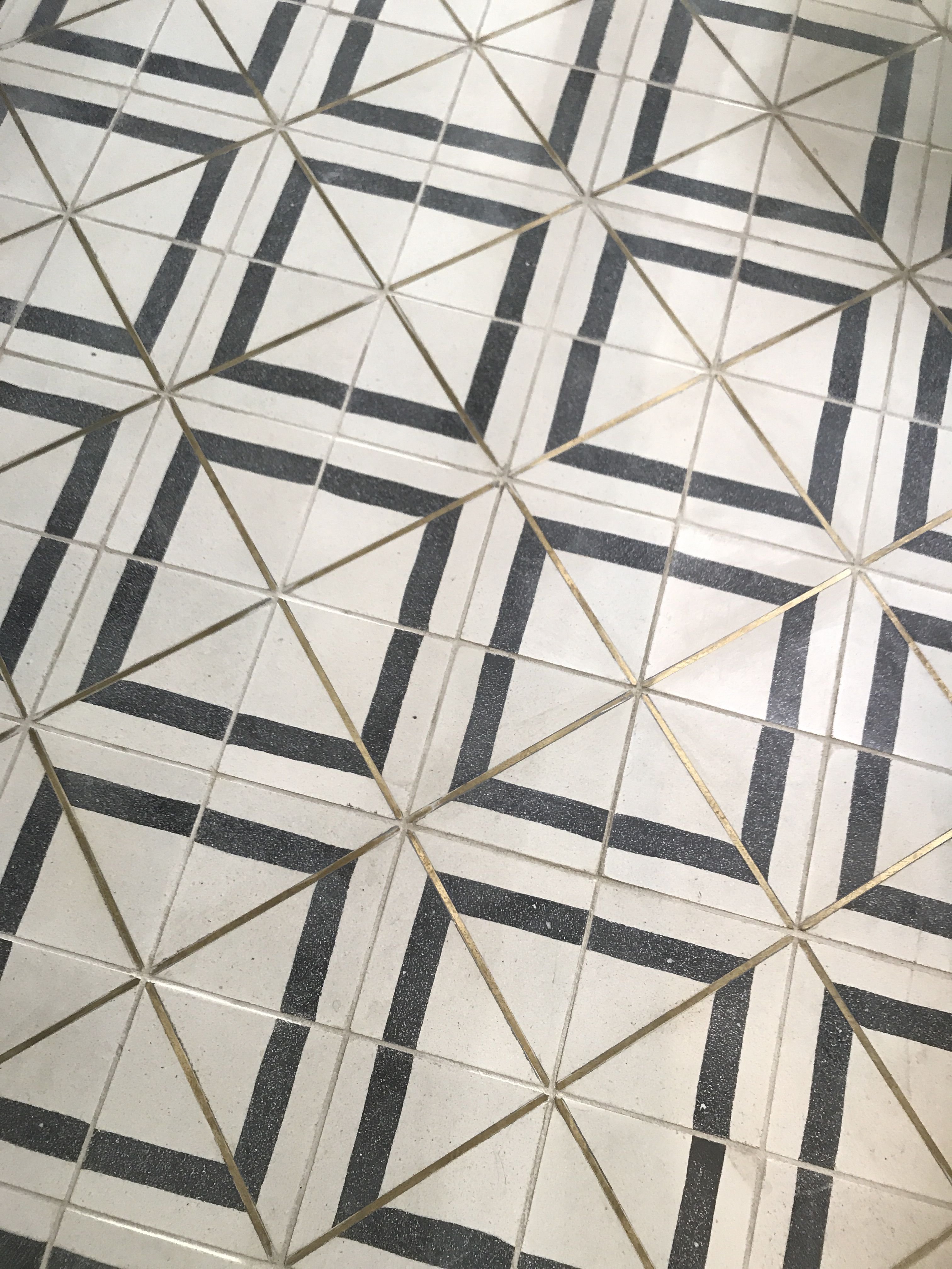 Brass Inlay And Black And White Terrazzo That Is Timeless