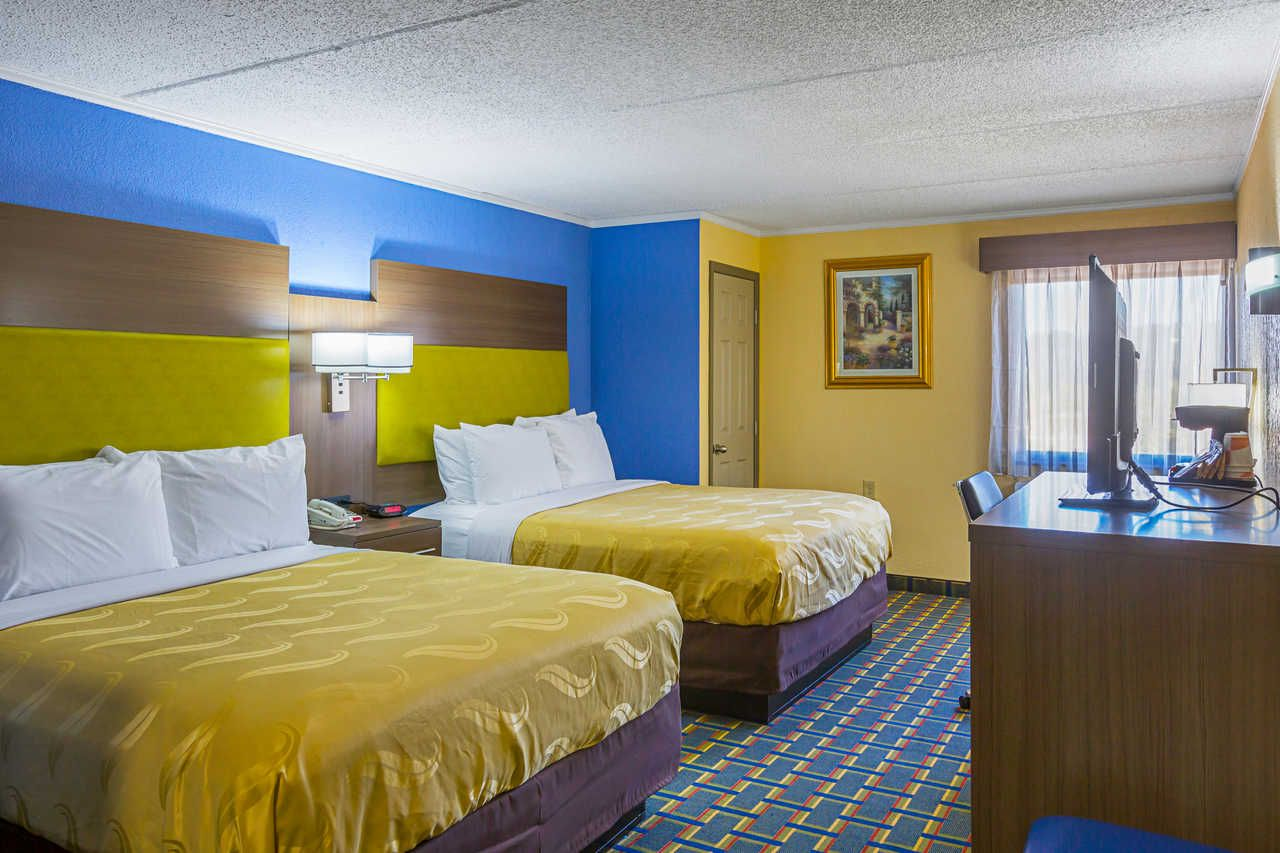 Clean Comfortable And Modern Rooms Equipped With Ice Cold A C And Flat Screen Tvs Providing Maximum Comfort King Qu Suites Atlanta Hotels Escape Room Game