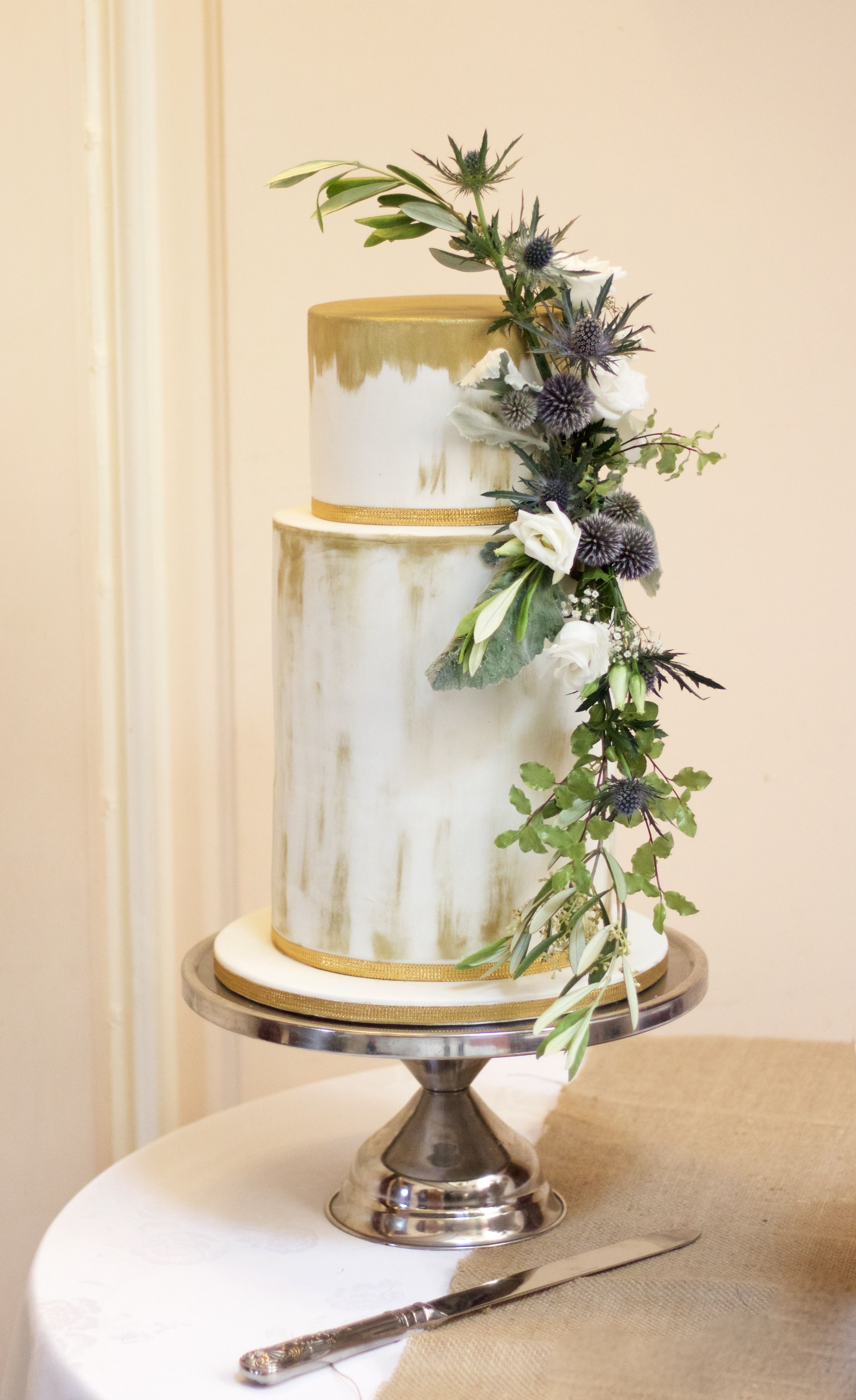 Extra deep two tier wedding cake with metallic painted detail and