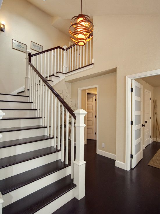 Entryway Dark Wood Floors And Stair Accents Living Room