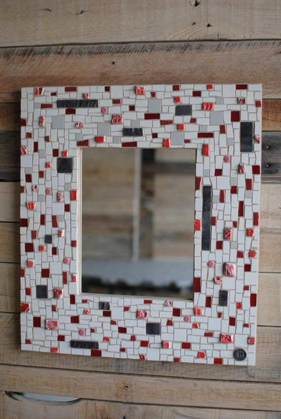 Red & White No. 1 is a field of flat white with a rhythmic, textured pattern of red and grey. Johannah used handmade ceramic tiles, stained