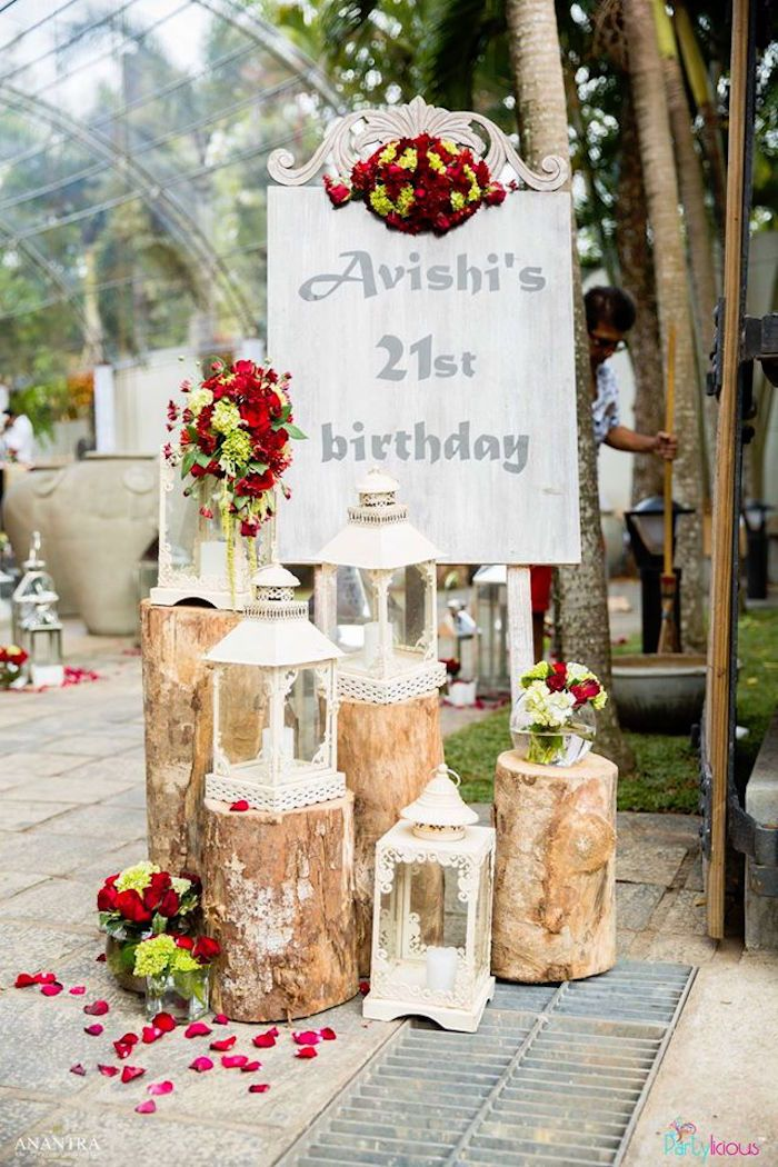 Welcome Sign With Rustic Logs Flower Petals And Lanterns From A Vintage 21st Birthday Party At Karas Ideas