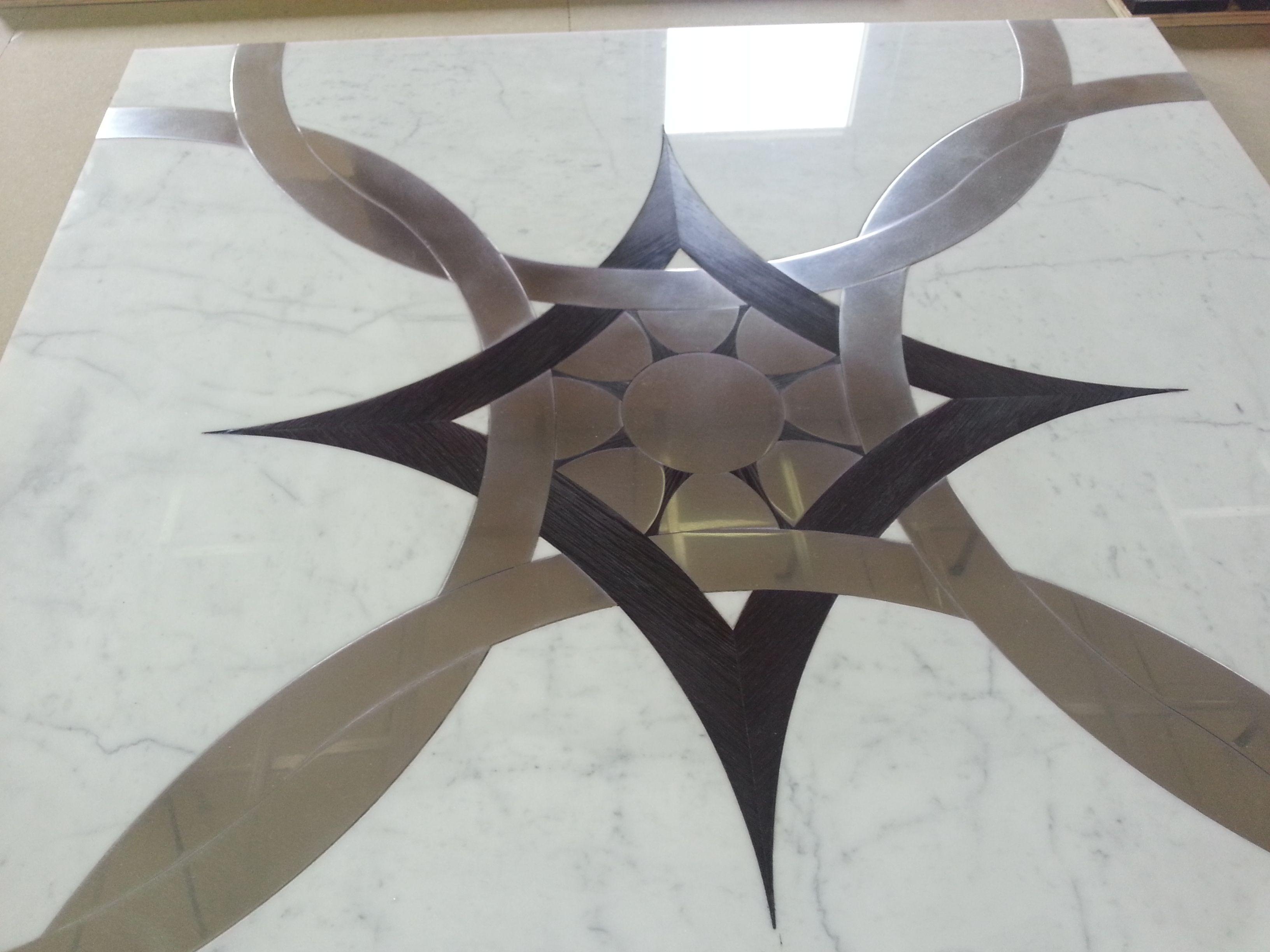 White carrara marble oak steel and all the craftsmanship for Ginardi arredamenti