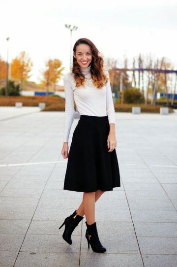 2b5d1ac236 25 Ways to Wear Midi Skirts - white fitted turtleneck worn with a black  midi skirt + ankle boots | StyleCaster
