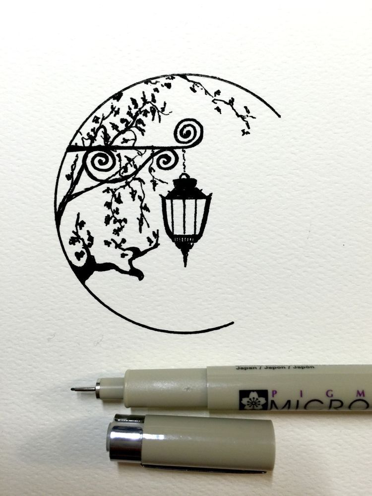 drawing of a lamp with branches in pen