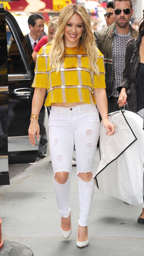 Hilary Duff seen out wearing a yellow and silver fringe top with ...